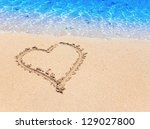 heart- a picture on sand - stock photo