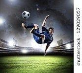football player in blue shirt... | Shutterstock . vector #129029057