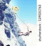 businesswoman climbing mountain ... | Shutterstock . vector #129031763