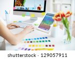 Female designer working with colors - stock photo