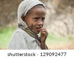Small photo of GONDER, ETHIOPIA - MARCH 25: Unidentified Ethiopian girl after praying during annual Abye Tsome (Great Fast) in Gonder, Ethophia on March 25, 2012. Crosses on her face is a symbol of Holy Sacrament.