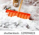 Shovel Being Pushed Through Snow