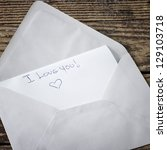 unsealed envelope on the table,I love you - stock photo