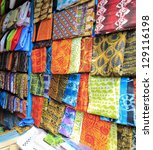 Bright cloth for sale at the market in Kumasi, Ghana - stock photo