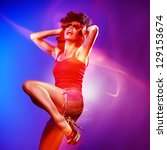 Beautiful woman with afro haircut is dancing disco. Photo with blurred effects. - stock photo