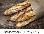 four baguette bread loaves in...   Shutterstock . vector #129173717