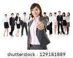 Smiling business executive woman of Asian give you an excellent sign in front of her team isolated on white background. - stock photo