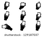 hand holding smartphone icons   Shutterstock .eps vector #129187037