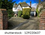 Mock Tudor house with drive in Swindon, UK - stock photo