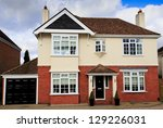 Large brick and rendered detached house in Swindon, UK - stock photo