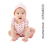 Full body Six months old East Asian baby girl sitting on white background - stock photo