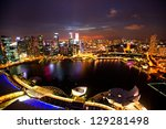 SINGAPORE - APRIL 15: A view of city from roof Marina Bay Hotel in night on April 15, 2012 on Singapore. This hotel is billed as the world's most expensive standalone casino property at S$8 billion. - stock photo