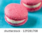 Close-up of vanilla flavoured macaroons on a turquoise serviette - stock photo
