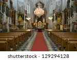 Beautiful richly decorated interior of the church in europe - stock photo