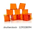 Orange jelly cubes on white background - stock photo