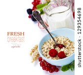 bowl of oat flake, berries and fresh milk on white background - health and diet concept (with easy removable sample text) - stock photo