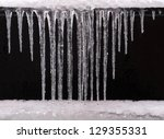 Winter ice and icicles - stock photo