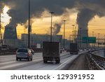 SAINT-PETERSBURG, RUSSIA-DECEMBER 23: City ringway with air pollution from heat electric generation plant on December 23, 2012 in Saint-Petersburg, Russia. Strong vapor and smoke due extreme cold - stock photo