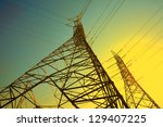 The power transmission towers of sky background - stock photo