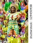 RIO DE JANEIRO - FEBRUARY 10: A woman in costume dancing on carnival at Sambodromo in Rio de Janeiro February 10, 2013, Brazil. The Rio Carnival is biggest carnival in world. - stock photo