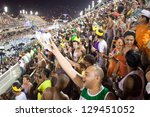 RIO DE JANEIRO - FEBRUARY 10: Spectators welcome participants on carnival Sambodromo in Rio de Janeiro February 10, 2013, Brazil. The Rio Carnival is biggest carnival in world. - stock photo