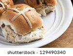 Warm toasted hot cross bun - stock photo