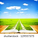 Open book of nature with way - stock photo