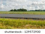 District road, view to the country landscape. - stock photo