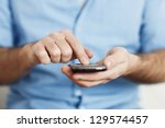 man texting on mobile phone