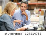 business colleagues working at... | Shutterstock . vector #129614753