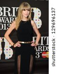 Taylor Swift arrives for the Brit Awards 2013 at the O2 Arena, Greenwich, London. 20/02/2013 Picture by: Steve Vas - stock photo