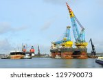 crane vessel and oil tanker | Shutterstock . vector #129790073