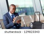 black businessman using tablet... | Shutterstock . vector #129823343