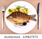 Fried Fish On White Plate With...