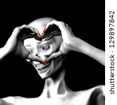 Zombie's in Love - Lady zombie making a heart symbol with her hands..Isolated on a black background. - stock photo