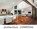 Luxurious home interior with large sliding doors - stock photo