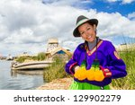Indian woman in Peru at lake Titicaca - stock photo