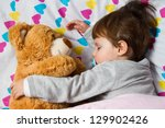 Sweet child sleeping with teddy bear - stock photo