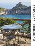Table and chairs overlooking the Mediterranean on the amalfi coast. - stock photo