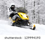Man On Snowmobile In Winter...