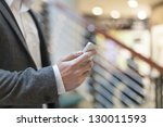 man with smart phone on hand ... | Shutterstock . vector #130011593