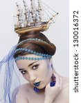 sea queen. face of the young beautiful girl make-up in sea style - stock photo