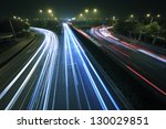 View dusk urban rainbow light night traffic on the highway skyline - stock photo