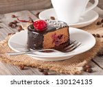 Sweet dessert fruitcake with a cherry and a cup of coffee - stock photo