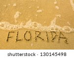 Florida - written in sand on beach texture - soft wave of the sea. - stock photo