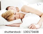 Portrait of couple sleeping in the bed - stock photo