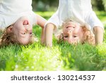 happy children standing upside... | Shutterstock . vector #130214537