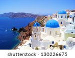 Blue and white churches of Oia village, Santorini, Greece - stock photo