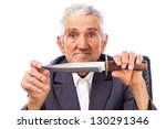 Portrait of an old man holding a knife and looking at camera on white background - stock photo
