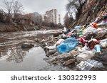illegal landfill near city sewer | Shutterstock . vector #130322993